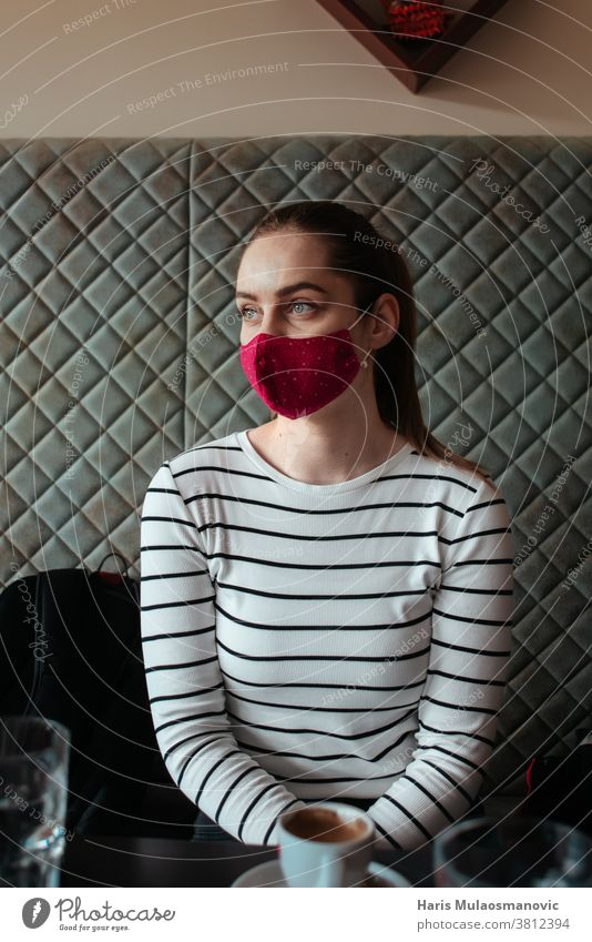 Woman with face mask, traveler warming up in coffee shop backpack bags cafe cafe shop caucasian cool corona virus covid covid-19 cup fired future glass indoor