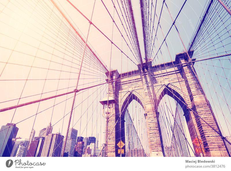 Vintage toned picture of Brooklyn Bridge, New York City, USA. vintage city landmark Manhattan filtered retro architecture sky urban America view day summer