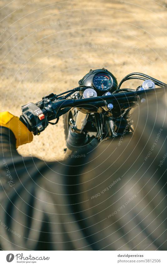 Motorcycle handlebar and odometer top view motorcycle motorbike speedometer gloves vintage biker man detail custom retro rider vehicle grab transport young