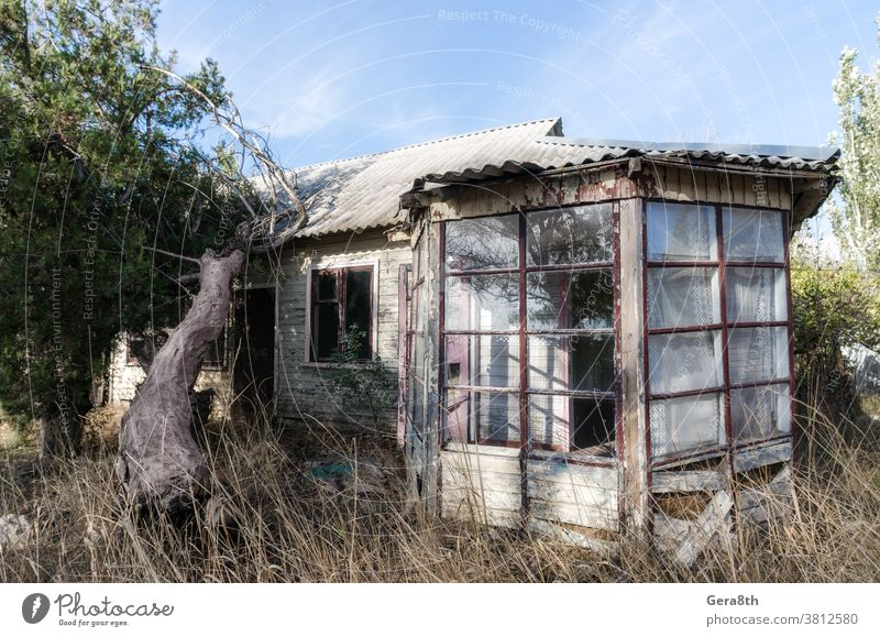 old abandoned wooden village house in Ukraine abandoned house architecture autumn blue building conflict construction country house crisis day derelict desert