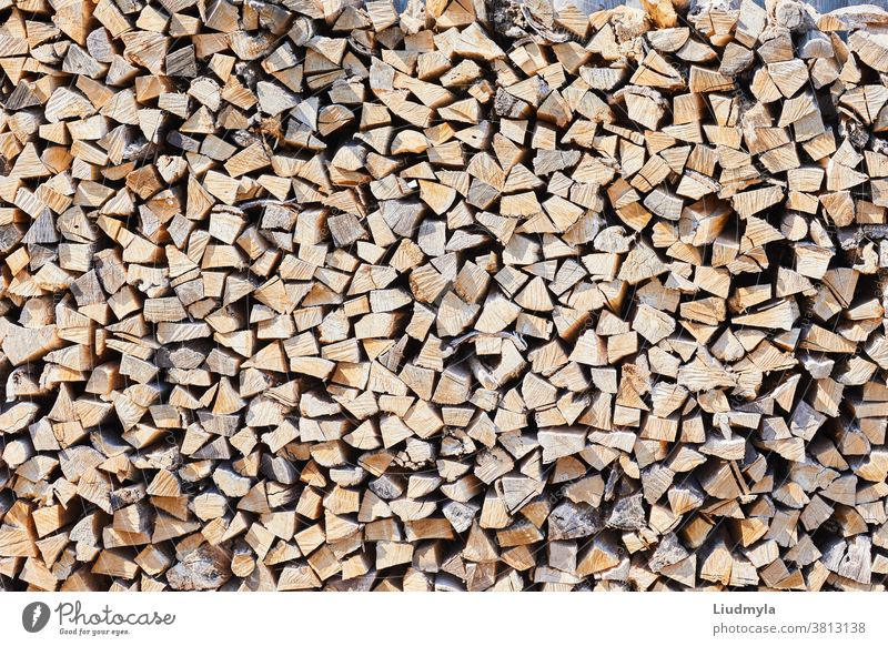 Stacks of firewood in the sawmill. Pile of firewood. Firewood background business chopped cords of firewood craft cut dry ecologic environment factory