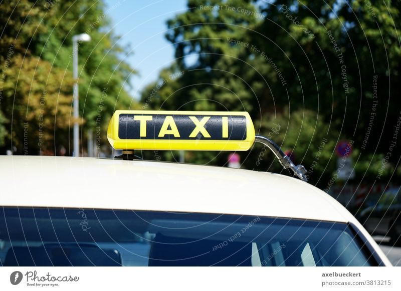 german taxi sign on car roof cab yellow taxi stand taxicab closeup close-up urban traffic city street transport transportation travel copy space copyspace