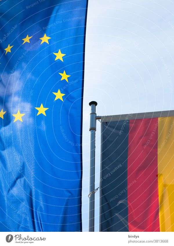 European flag in the foreground and German flag in the background EU European Union Flags and banners brd Member State Politics and state Federalism Germany