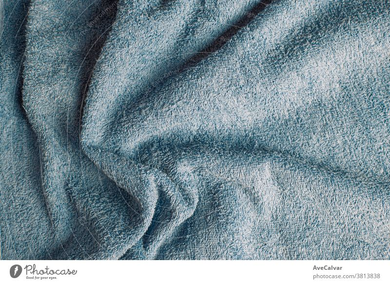 Top view of a light blue towel with some wrinkles blanket material background pattern fuzzy fleece white warm design plush texture cream soft textile fur clean