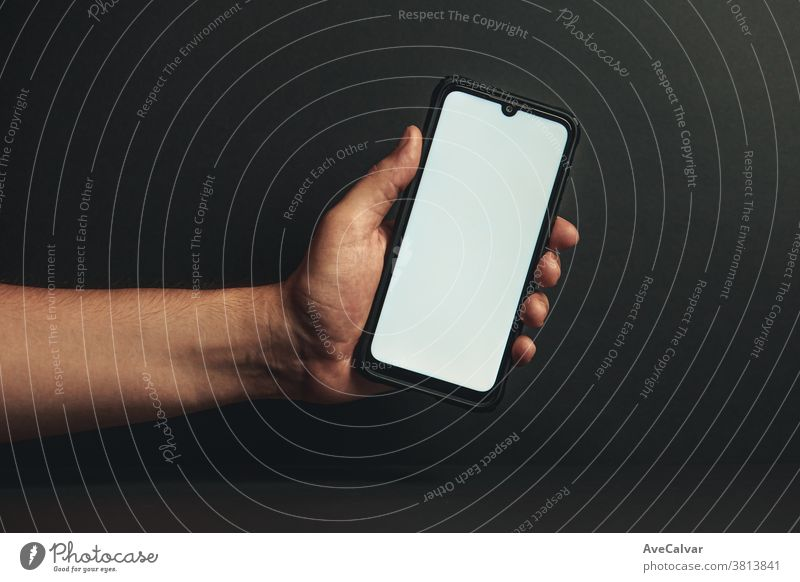 Young hand holding a phone with a white screen business computer woman lifestyle social smartphone technology tablet closeup shoulder device iphone background