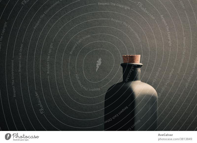A close up of a black ceramic bottle with a dark background mock-up gin scotch rum irish trendy brandy design matte space malt black background object cream