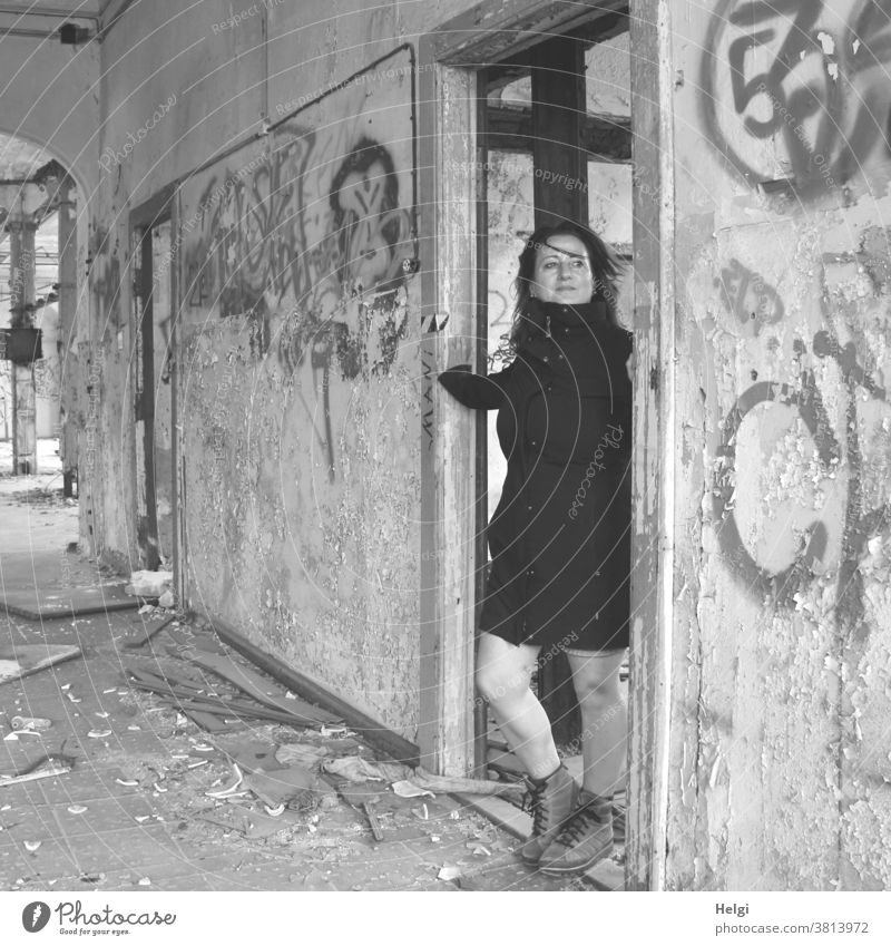 for bitti - long-haired woman in black coat standing in a doorway of an old dilapidated building Human being Woman Building lost place Wall (building) Doorframe