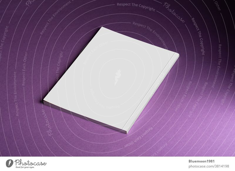 Book with blank cover on purple backdrop mock-up editable change book template realistic black paperback advertising business booklet branding close replace