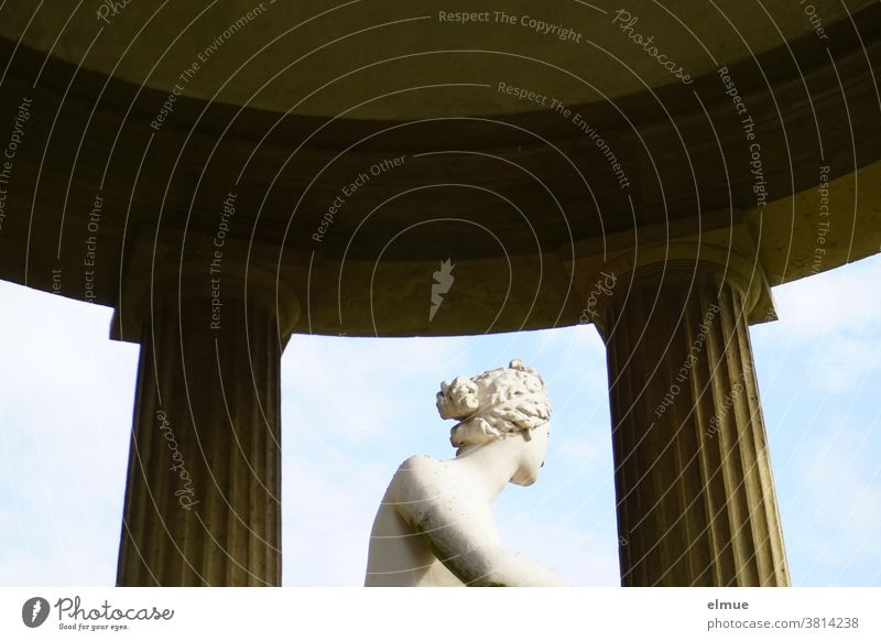 The Roman goddess of love and beauty in the temple of Venus looks somewhat embarrassed into the distance. Goddess Temple of Venus Statue averted partial view