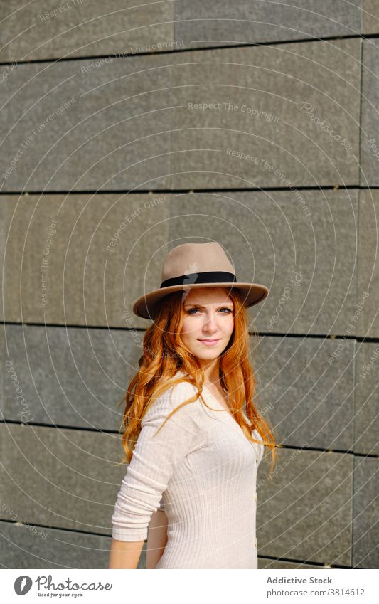 Smiling redhead woman in hat style smile trendy red hair urban modern positive young female fashion long hair lady confident charming lifestyle cheerful elegant