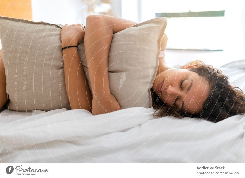 Happy young woman resting on bed bedroom happy awake morning lying optimist at home female relax cozy comfort smile cheerful joy delight eyes closed pleasure