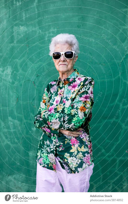 Stylish elderly woman in trendy sunglasses senior style hipster cool colorful outfit female fashion urban lifestyle bright individuality crazy happy cheerful
