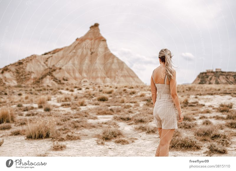 Young woman on the desert tourist blonde young 20s tourism travel copy space one mountain barcenas reales navarra iconic landmark spain nature tour tourism