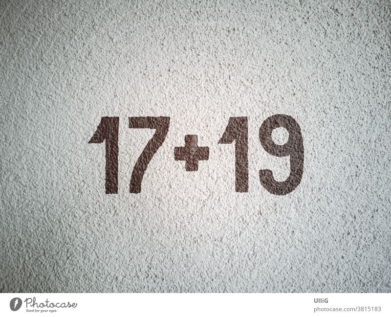 Calculation 17 plus 19 - house numbers, shown as calculation 17 + 19 on a house wall. House number Mathematics calculation task digit Wall (building)