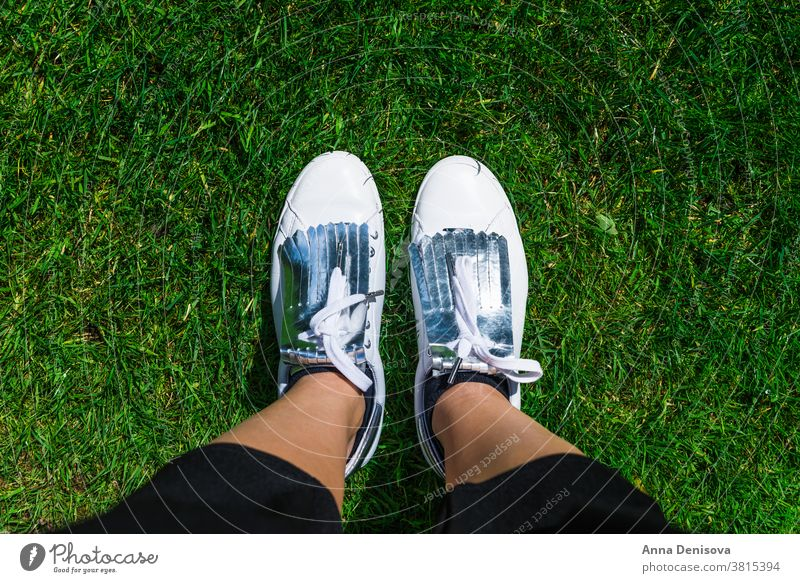 Yound Woman in White Sneakers, Top View white sneakers shoes fashion wear style foot legs hiking sport jeans street grass park walking above top view selfie