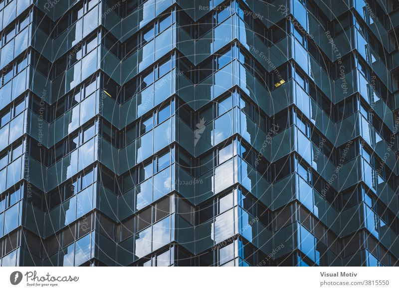 Geometric glazed facade of an office building architecture exterior structure construction windows urban metropolitan edifice geometric abstract design modern