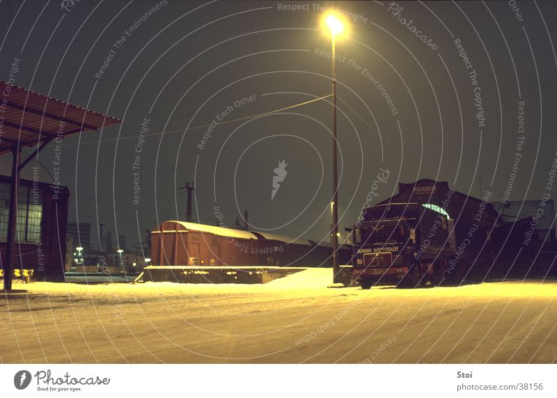 Goods station at night Freight station Railroad Night Cold Loneliness Winter Street lighting Train station Snow Calm Industrial Photography