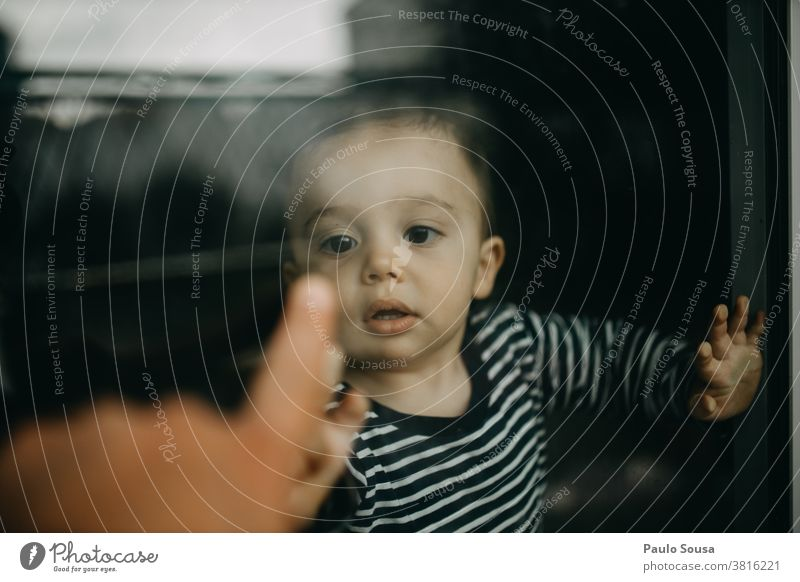 Child playing with father through window through glass Window Authentic Toddler childhood reflection quarantine home isolation Family & Relations Lifestyle Love