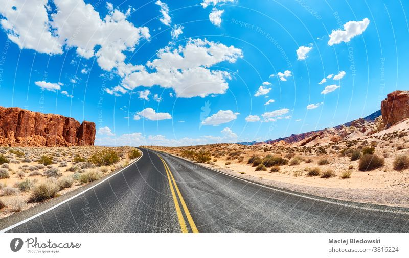 Scenic road in Valley of Fire State Park, Nevada, USA. desert highway trip journey nature travel valley landscape adventure wanderlust sandstone formations