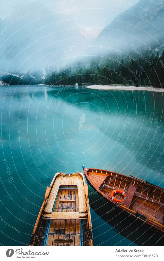 Wooden boat on clear lake in mountains turquoise water crystal vessel highland majestic wooden tranquil float calm scenic landscape nature idyllic peaceful pond