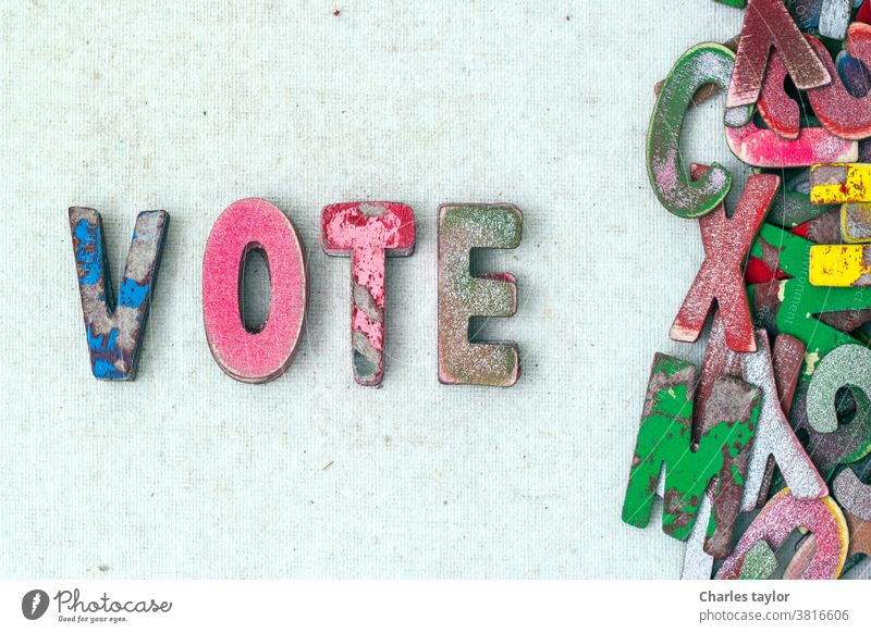 the word VOTE with old wooden letters vote voter politics concept symbol background voting text government choice president democracy america usa political