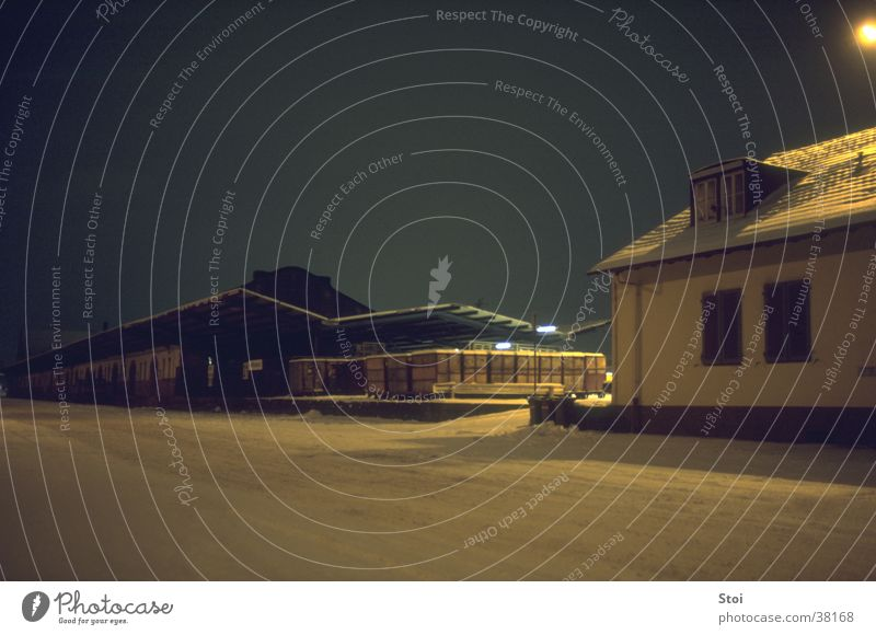 Goods station in winter night Night Winter Freight station Cold Loneliness Dark Snow Transport