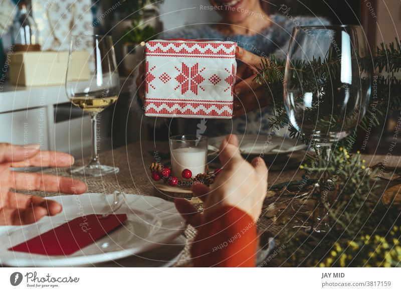 Happy family opening christmas presents, sisters give each other gifts at the  christmas table, Family Together Christmas  Concept. women´s together home happy