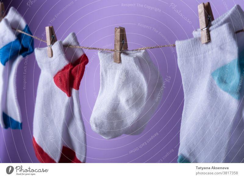 Premature baby day concept. Tiny socks premature prematurity awareness purple tiny november newborn small prevention birth disease infant child life pregnancy