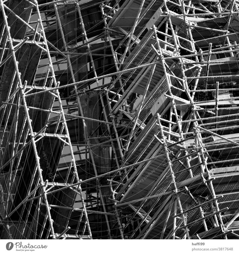 Scaffolding with ice crystals in winter - cold outside Setup Hoar frost Frost Construction site Winter Cold Building Facade Exterior shot Redevelop