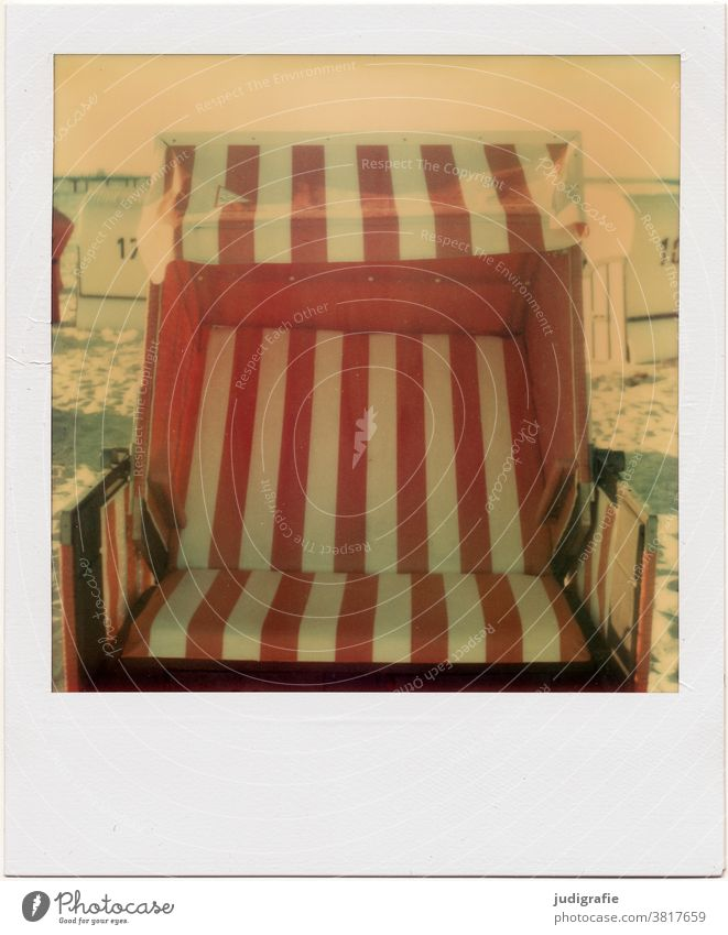 Empty beach chair on Polaroid Beach chair Baltic Sea Baltic coast Stripe Vacation & Travel Relaxation Colour photo Exterior shot Tourism strip vertical Red