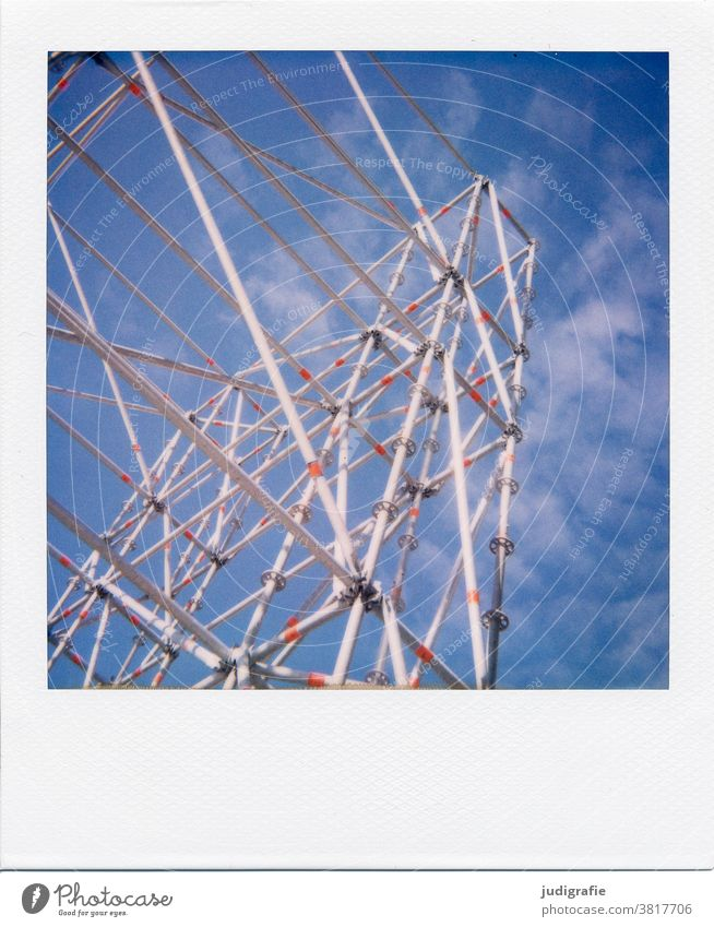 Scaffolding in front of a blue sky on Polaroid pole poles Construction Construction site Exterior shot Sky Deserted Colour photo