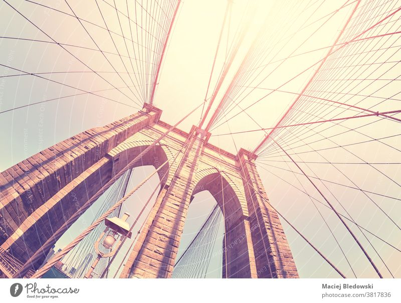 Color toned fisheye lens picture of Brooklyn Bridge, New York,  USA. brooklyn bridge new york city retro sun travel america urban landmark architecture view