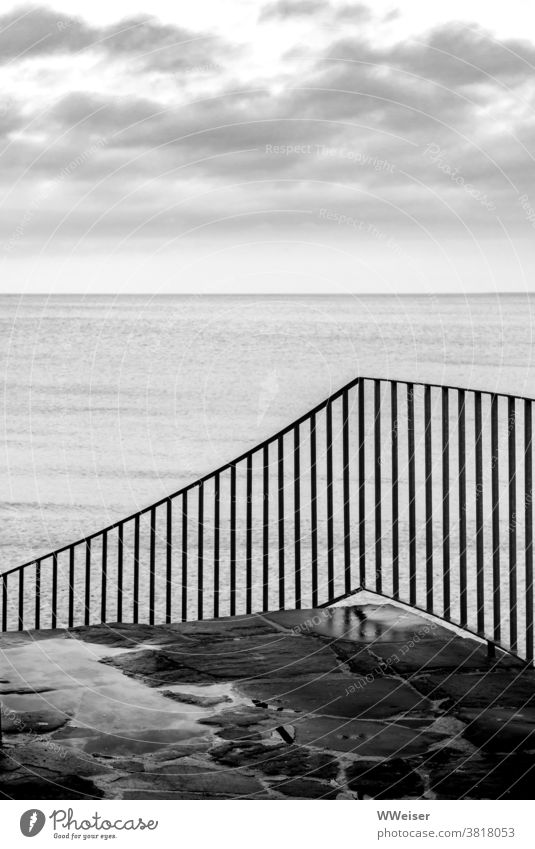 The wet stairs lead down to the beach Ocean Beach rail stagger Stone Wet Stairs Water Clouds Sky Rain Damp Deserted coast Baltic Sea Gray Dreary melancholically