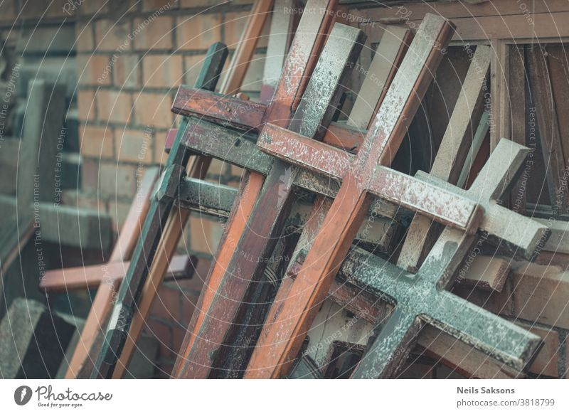 a lot of wooden Christian crosses on brick wall catholic catholicism christianity culture god cemetery jesus memorial monument religion religious tradition used