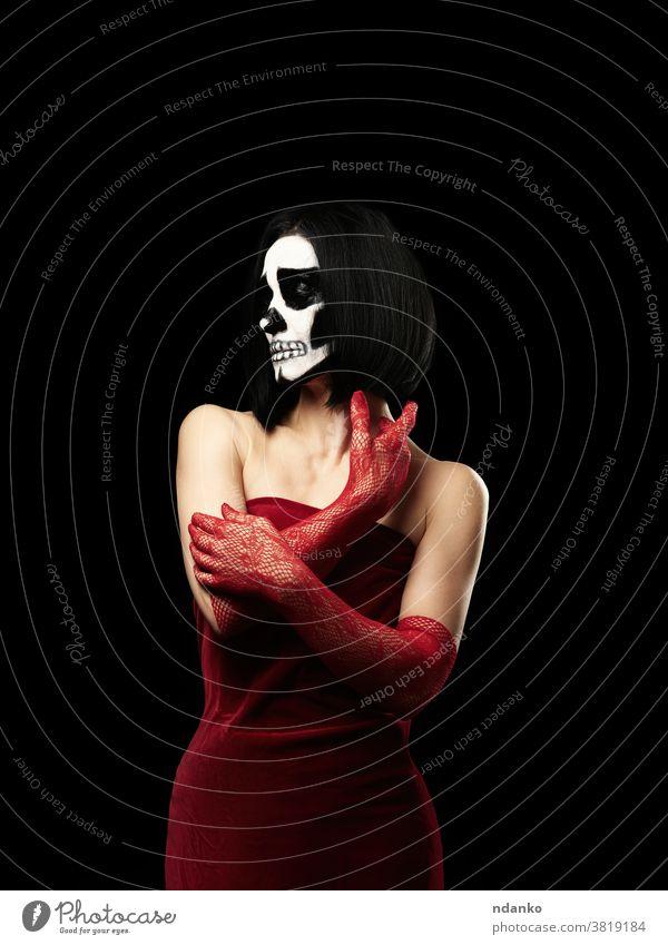 woman dressed in a red velvet dress, long fishnet gloves. Halloween Skeleton Makeup scary skeleton skull beautiful velor spooky studio sugar voodoo white witch