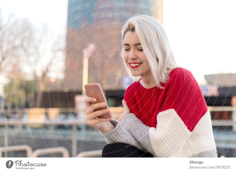 Close up portrait of beautiful young woman using cellphone outdoors in the city smartphone 1 smiling holding happiness standing street happy female mobile girl