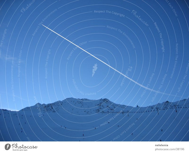 Condensation trails over the mountains Airplane Vapor trail Sölden Vacation & Travel Panorama (View) Glacier Mountain Snow Blue Sky Sports Flying Aviation Tall