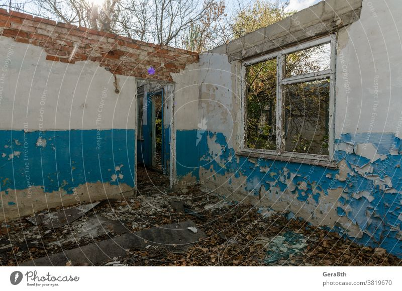 ruins of an old abandoned village house in Ukraine abandoned house architecture autumn blue building conflict country house crisis day derelict desert desolate