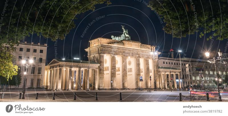 Brandenburg Gate at night with a treetop as a frame architecture attraction Berlin brandenburg brandenburger building built structure capital city city gate