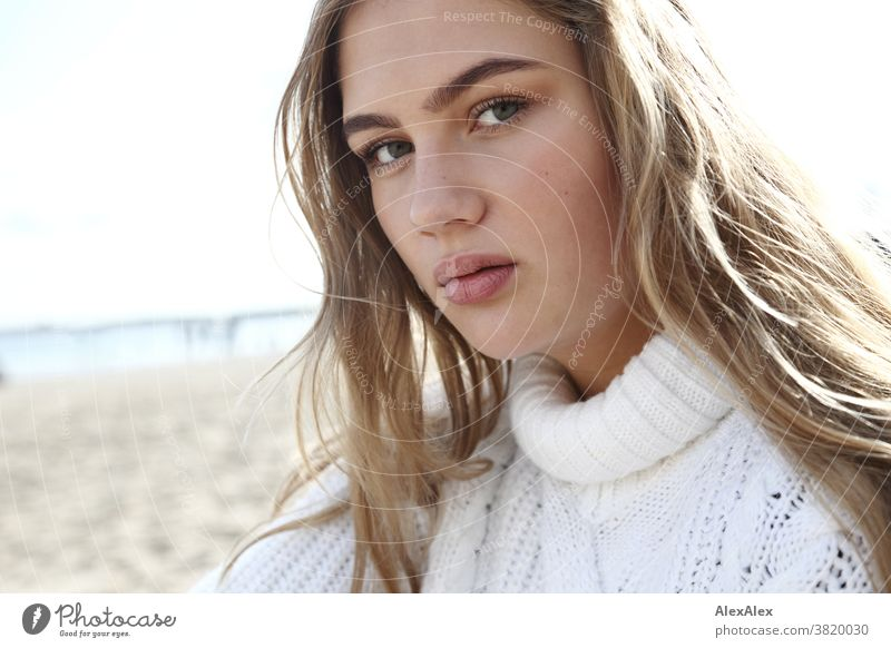 Blonde girl in white knitted sweater at the Baltic Sea beach Landscape Beach Intensive teen kind Nature feminine Uniqueness Exceptional natural light