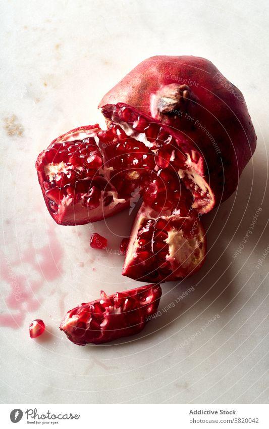 Fresh ripe halved pomegranate fruit healthy food red tropical juicy seed sweet vegetarian raw fresh natural half freshness closeup eating vitamin ingredient