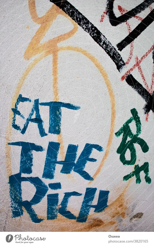 EAT THE RiCH eat the rich Graffiti Text writing Characters Letters (alphabet) Typography Word Wall (building) Communication invitation Slogan saying slogan