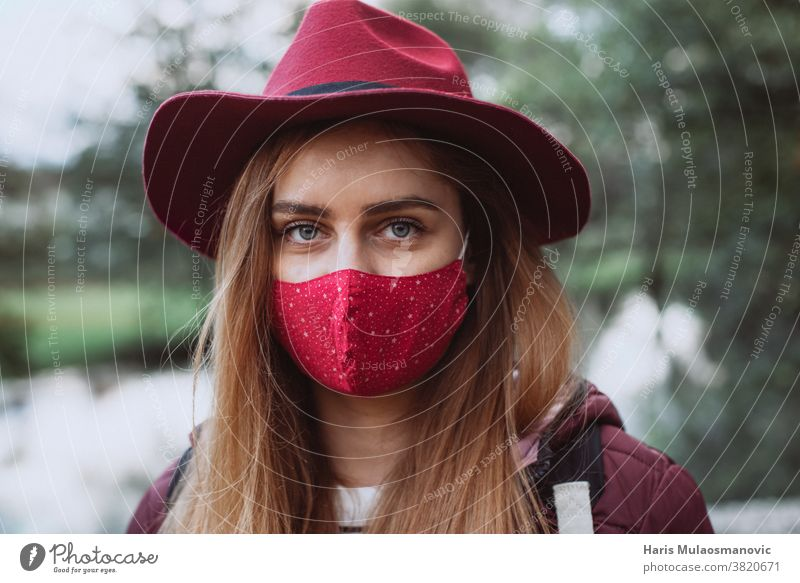 Beautiful woman with red hat and face mask close up adult attractive beautiful beauty caucasian cold coronavirus covid-19 cute fashion female girl lifestyle