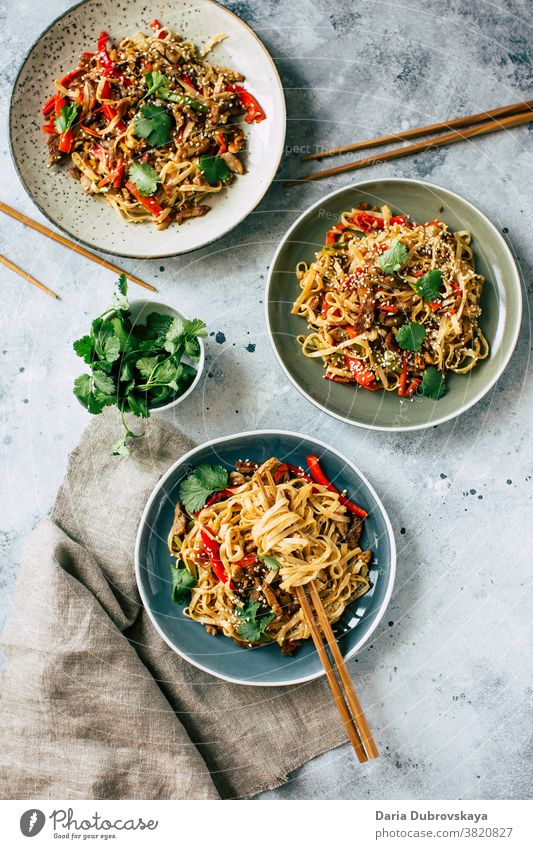 Udon noodles with vegetables and pork meat traditional food delicious cuisine soy udon japanese bowl sauce plate pepper fastfood roasted black asian cooking