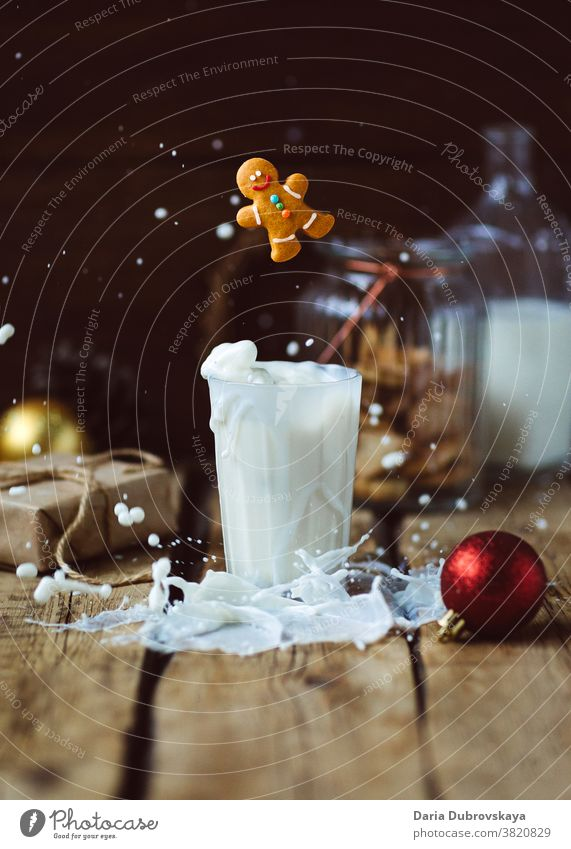 Gingerbread man and a glass of milk. Christmas concept sweet food gingerbread festive xmas candy drink christmas cookie december holiday celebration decoration