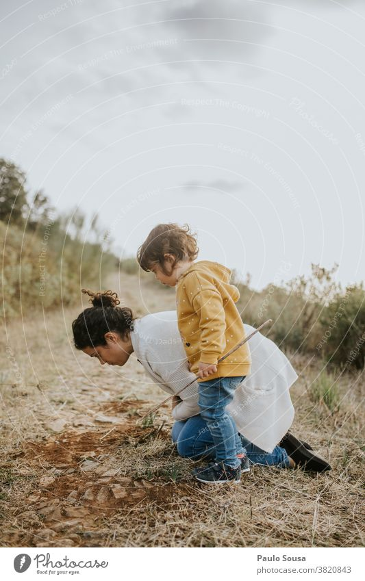 Mother and daughter playing outdoors mother and child Daughter Family & Relations Authentic Autumn Autumnal colours Child childhood Adventure explore Nature