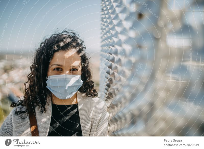 Curly woman with disposable mask Caucasian Woman 30 - 45 years Adults 18 - 30 years Colour photo Young woman Human being Central perspective Beautiful