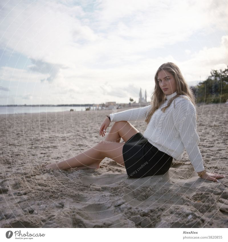Blonde girl at the Baltic Sea beach Landscape Beach Intensive teen kind Nature feminine Uniqueness Exceptional natural light Looking into the camera Observe