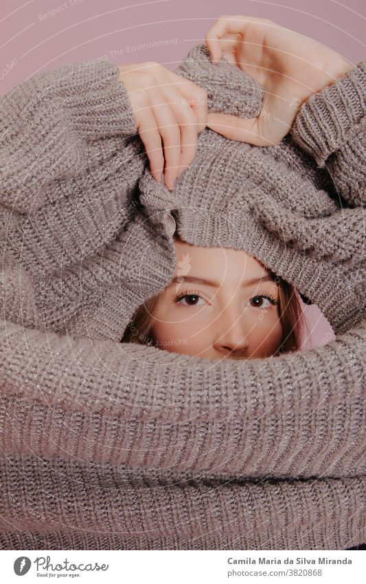 young woman wearing a sweater season close-up fashionable pullover blond portrait lifestyle background beautiful beauty caucasian clothing photo studio pink