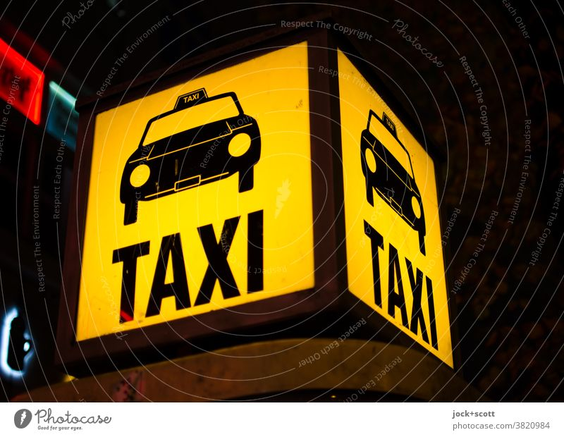 Taxi Taxi call box Berlin free of charge Site Taxi call point Mobility Lightbox Illuminate Pictogram Word Artificial light Yellow Night Design Square Services